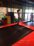 Doing acrobatics on Trampoline