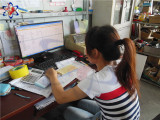 Busy working time of the girl who take care of warehouse