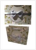 Big ribbon bow on gift bag