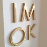 brushed brass letter with varnish coating