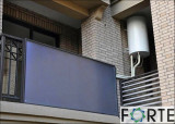 Balcony mounted flat plate solar collector