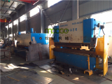 Fabricating machinery in MOOGE workshop