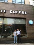 with customer in coffee