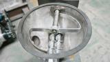 Volumetric twin screw metering feeder