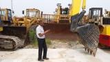 African Customer Checking Excavator