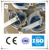 Turning corner wheel assembly for poultry slaughtering line