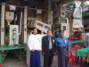 Our engineer and the customers in Myanmar before our rice milling machine
