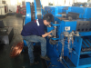 Engineers assembling machine