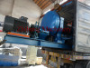 Loading two roll rubber mixing mill