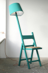 This Do-All Folding Chair Has a Lamp Included