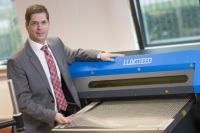 Luxexcel CEO Richard Van De Vrie Pictured in Front of One of The Company's 3D Printers