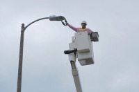 Mayor Bob Foster Climbs in a Cherry Picker to Christen Pilot LED Street Lights