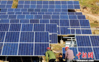 China to Cut Price of Wind Power, PV