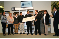 Beaulieu Presents Sergio Triana with a Check for $1,000