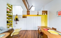 Colorful Apartment With A Multi-Functional Wall Unit