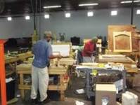 Standard Furniture Production Employees Are at Work in a Cell Area That Assembles Mirrors