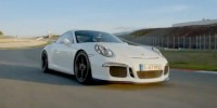The All-New 991-Based Porsche 911 Gt3 Being Hustled Around a Racetrack
