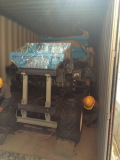 Plam oil tractor put into container