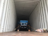 Palm oil tractor already put into container