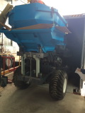 Palm oil tractor begin to put into container