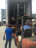 Forklift helps to put into container