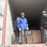 Workers Loading Container In Factory